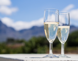 Champagne Flutes standing on a table before a Mountain Range